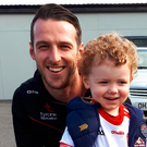 Fan power: One of Tyrone's younger supporters, Tom Bogue, with Niall Morgan (left) and DD Mulgrew
