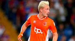 Former Celtic and Blackpool ace John Herron has joined Glentoran on a one-year deal.