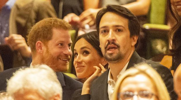 The Duke and Duchess of Sussex take their seats next to Lin-Manuel Miranda (Dan Charity/The Sun)