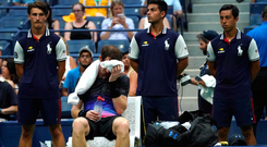 Down and out: Andy Murray struggles in the heat at Flushing Meadows