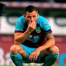 Over and out: Burnley's Phil Bardsley dejected last night
