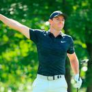 Mixed day: Rory McIlroy alerts fans to a wayward drive in Boston