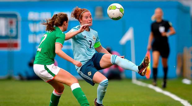 Closed down: Republic of Ireland's Heather Payne puts pressure on Marissa Callaghan in yesterday's clash