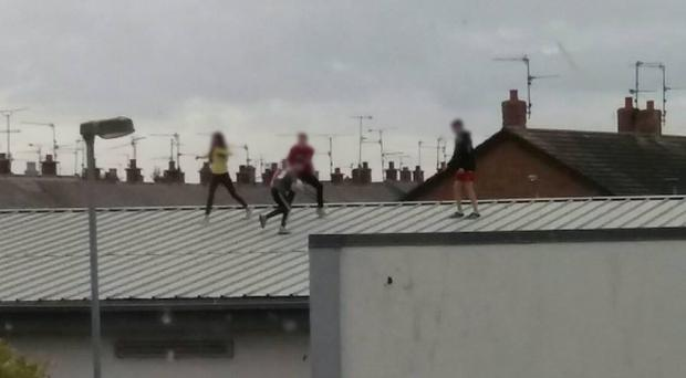 Children playing on the roof of a vacant Lidl store in Lurgan. Credit: PSNI