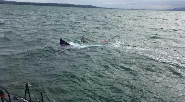 The boat sank despite efforts to tow it to shore. Credit: Donaghadee RNLI