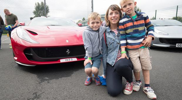 Fiona Smith with her sons Alex and Timmy at the Ferraris @ Friends school Lisburn.. (Photo by Colm O'Reilly, Sunday Life)