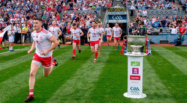 Daring to dream: Tyrone players take to the Croke Park pitch hoping to get their hands on the Sam Maguire Cup but it was Dublin's Philip McMahon who was celebrating at the finish