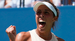 Job done: Madison Keys hails her victory to reach quarters