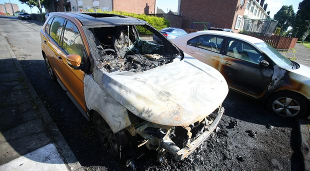 The scene in the Riverside area of Dunmurry in south Belfast where three cars were damaged in the early hours of Tuesday morning after an arson attack. Picture by Jonathan Porter/PressEye