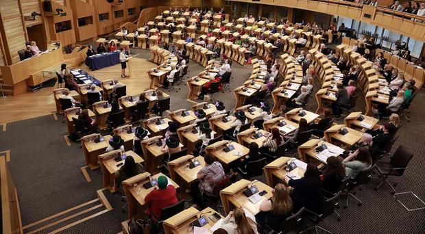 The BBC's Question Time programme is to be broadcast from Holyrood's debating chamber (Andrew Cowan/PA)
