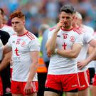 Hard to take: the dejected Tyrone team at the final whistle on Sunday at Croke Park