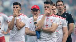 Looking ahead: Mickey Harte with his dejected Tyrone players after the All-Ireland final defeat to Dublin at Croke Park last Sunday