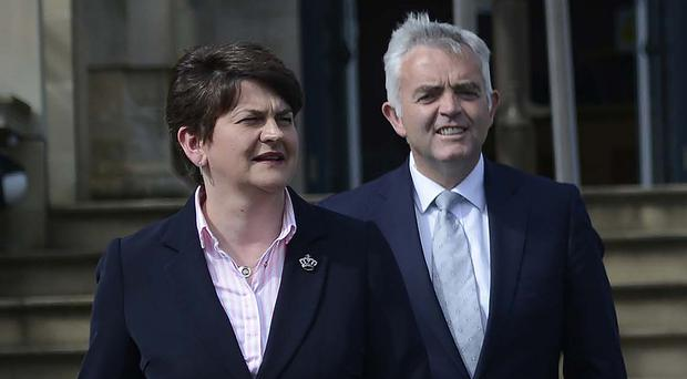 Arlene Foster and Jonathan Bell pictured together in 2015.