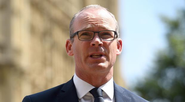 Simon Coveney said he did not agree with Mr Trump on a number of policy areas (Kirsty O'Connor/PA)