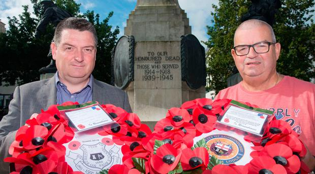 Alderman David Ramsey and Victor Wray with the poppy wreaths which will be laid at the Cenotaph in Londonderry