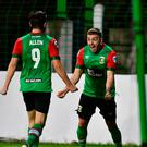 Leading man: Curtis Allen rushes to salute scorer Robbie McDaid