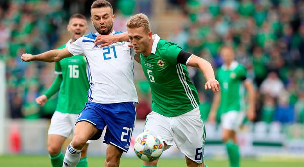 Northern Ireland's George Saville (right) and Bosnia and Herzegovina's Elvis Saric battle for the ball.