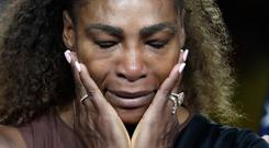 Serena Williams reacts during the trophy ceremony after losing to Naomi Osaka, of Japan, in the women's final of the U.S. Open tennis tournament, Saturday, Sept. 8, 2018, in New York. (AP Photo/Julio Cortez)