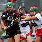 Final fight: Cork's Sarah Harrington and Deirbhile Savage of Down battle it out