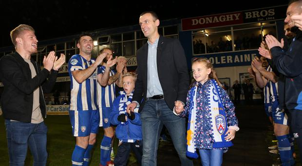 Thanks boss: Coleraine players salute Oran Kearney and his children, twins Luca and Ava, during Saturday evening's farewell.