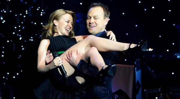 Kylie Minogue and Jason Donovan during the Hit Factory Live Christmas Cracker concert (Ian West/PA)