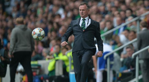 Under control: Michael O'Neill says Northern Ireland will put their regrets to good use in future
