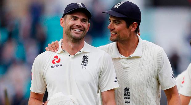 New record: James Anderson (left) with Alastair Cook