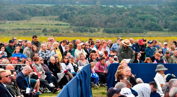 Spectators wait for President Donald Trump and First Lady Melania Trump (inset) at the September 11th Flight 93 memorial in Shanksville