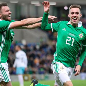 One touch: Gavin Whyte (right) celebrates his Northern Ireland debut goal with Stuart Dallas.