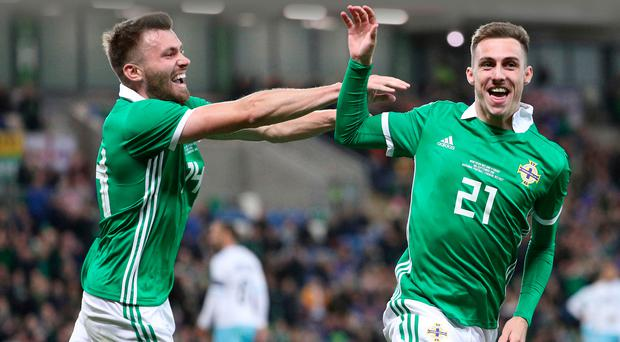 One touch: Gavin Whyte (right) celebrates his Northern Ireland debut goal with Stuart Dallas, who netted the sccond