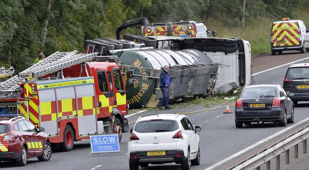 General views of a tanker lorry which has overturned on the M2 Motorway close to Antrim. Mandatory Credit: Stephen Hamilton /Presseye
