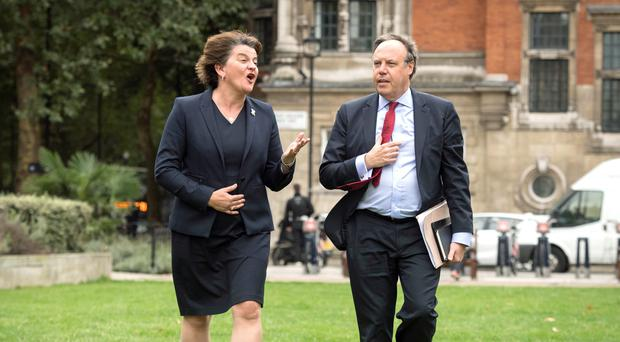 "DUP leader Arlene Foster and deputy leader Nigel Dodds met the Prime Minister in Westminster on Wednesday. Mrs Foster urged her not to ""subcontract"" the British Government's responsbilities. Stefan Rousseau/PA."