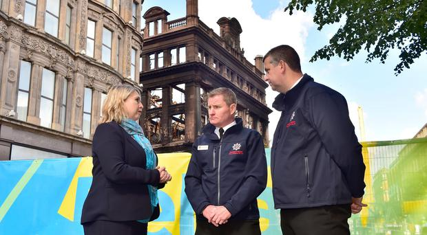 Secretary of State Karen Bradley talks with Assistant Chief Fire Officer Michael Graham and Eastern Area Commander Aidan Jennings outside the Primark building. Photo by Simon Graham Photography