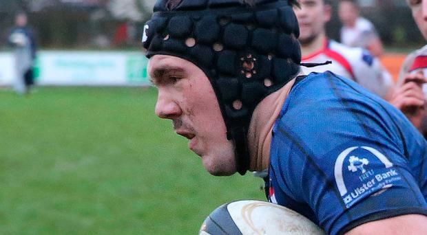 In centre: Conor McKee could be in action for Queen's