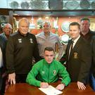 Glentoran have completed their summer signings by bringing in teenager Chris Gallagher.