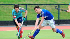 Pressure on: Portadown's Gregory Croft clashes with Belfast Harlequins ace John Metcalfe