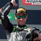 So close: Jonathan Rea celebrates victory in Portugal yesterday