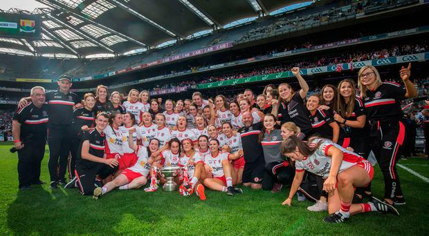 Just reward: Tyrone, including Emma Mulgrew (right) celebrate their All-Ireland Intermediate final triumph