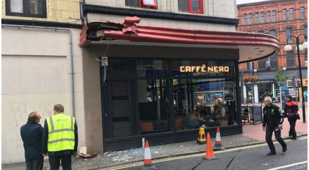In September 2018 a bus crashed into the awning of Caffé Nero in Belfast city centre. Credit: BBC