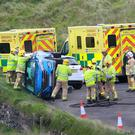 The scene of a crash close to Dunluce Castle on the Co-Antrim coast, near Bushmills on Monday evening. Condition of those involved unknown - Credit: Margaret McLaughlin