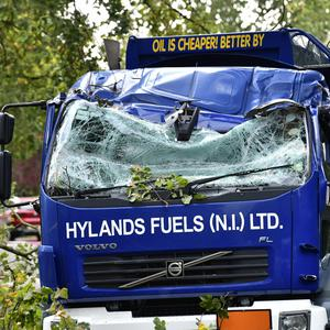 Pacemaker Press 19/08/2018 A fallen tree hits a oil lorry on Osbourne Park near the Lisburn Road in Belfast during the heavy winds on Wednesday. Thirty-two thousand homes across Northern Ireland are without electricity as Storm Ali intensifies. An amber weather warning is in place and wind gusts of up to 65mph are expected inland. Higher gusts are likely in the north west and north coast. The storm is due to reach its peak before 12:00 BST. Pic Colm Lenaghan /Pacemaker