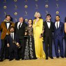 Nikolaj Coster-Waldau, from left, Peter Dinklage, Conleth Hill, Emilia Clarke, Gwendoline Christie, Isaac Hempstead Wright, Jacob Anderson, Nathalie Emmanuel, Liam Cunningham, and Kit Harington pose in the press room with the award for outstanding drama series for