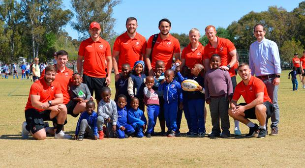 On tour: Ulster Rugby players and staff attended St. Andrew's School yesterday to coach and mingle with children from Bloemfontein townships, in conjunction with local charity Mosamaria