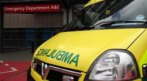 A Belfast woman was put on hold for twelve minutes after calling an ambulance.