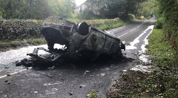 The burning car was discovered on its roof. Credit: PSNI.