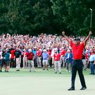 Tiger Woods celebrates his first PGA Tour win since 2013.