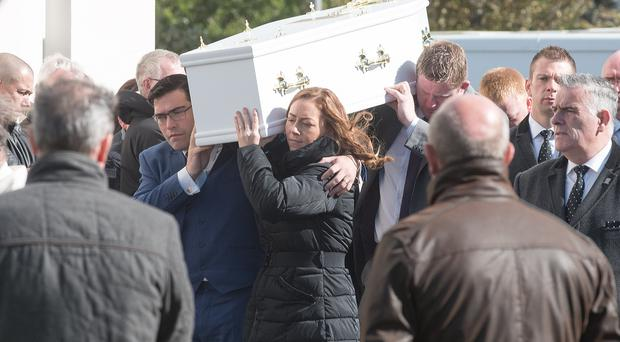 James and Janice Bradley carry the coffin of their son Daniel at St Patrick's Church in Maghera