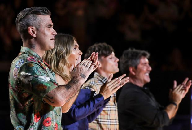 Robbie Williams with his fellow X Factor judges