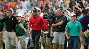 Tiger Woods has retaken golf's centre stage with Rory McIlroy left waiting in the wings.