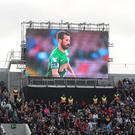 A tribute screen displaying photographs of Liam Miller (Niall Carson/PA)